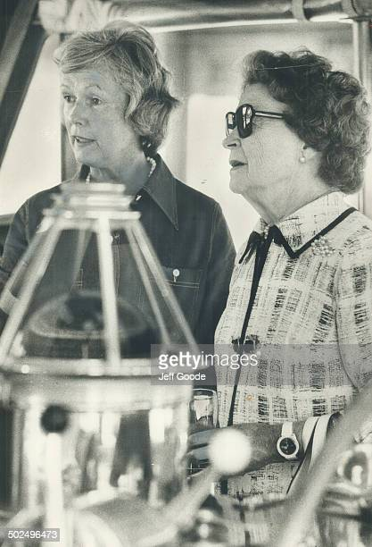 Maryon Pearson widow of former prime minister Lester Pearson chats with Mrs George Kitching at a cocktail party aboard the yacht Sea Star docked at...