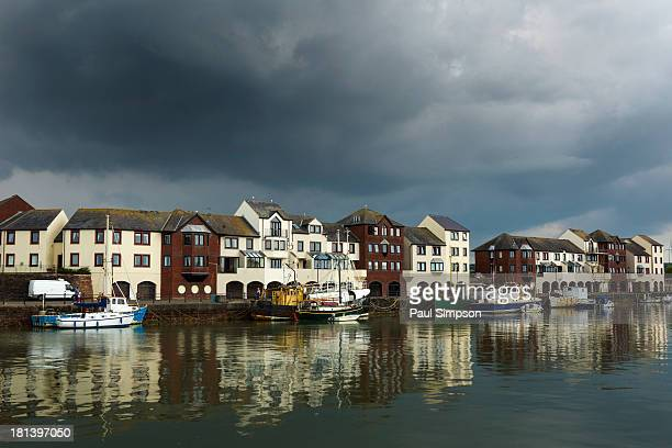 CONTENT] Maryport a town in England with its own fishing harbor seen here on a dull and stormy day Nice reflections in the water though