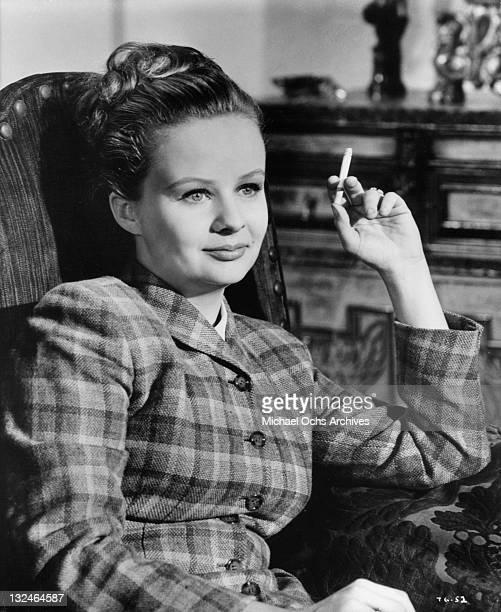 MaryRobin Redd sitting and relaxing with a cigarrette in a scene from the film 'The Group' 1966