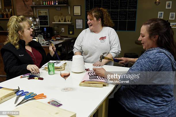 MaryRuth Tracy center laughs as she chats with Rachel Munoz Florido left and Karen Kucera as they make string art at Tracy's Place in Arvada Colorado...