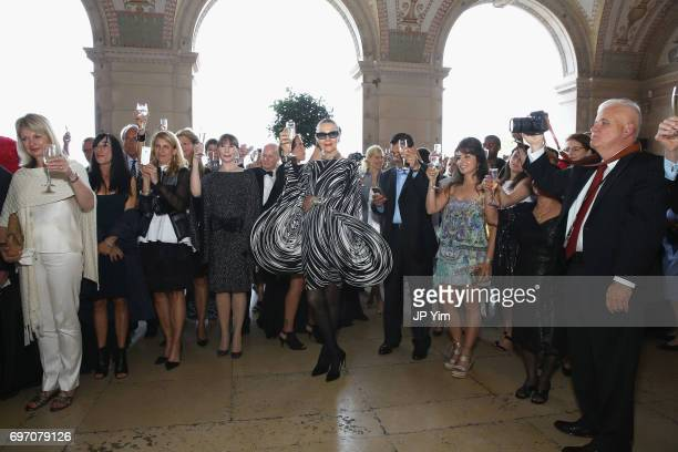 Maryse Gaspard and guests toast to Pierre Cardin's 95th Birthday Celebration during the Pierre Cardin 70 Years of Innovation fashion show at The...
