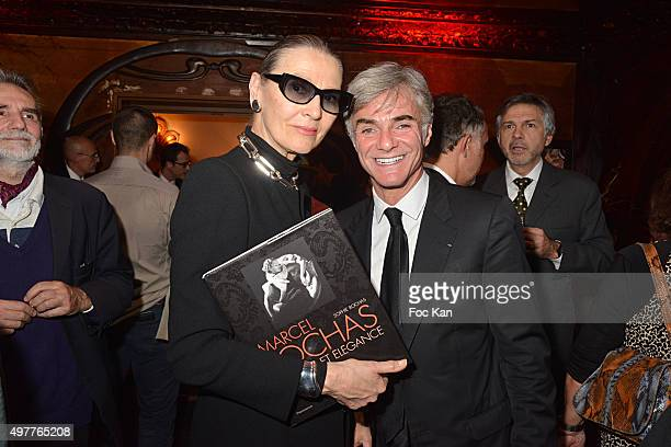 Maryse Gaspard from Cardin and Cyril Viguier attend the 'Marcel Rochas Audace et Elegance' Sophie Rochas Book Signing Cocktail at Maxim's on November...