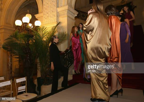 Maryse Gaspard prepares models for the Pierre Cardin 70 Years of Innovation fashion show at The Breakers on June 17 2017 in Newport Rhode Island