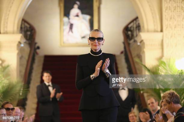Maryse Gaspard walks the runway at the Pierre Cardin 70 Years of Innovation fashion show at The Breakers on June 17 2017 in Newport Rhode Island
