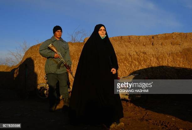 TOPSHOT Marzia Amiri an Afghan policewoman works on a homicide investigation in Karukh district of Herat province on February 2 2018 Marzia Amiri is...