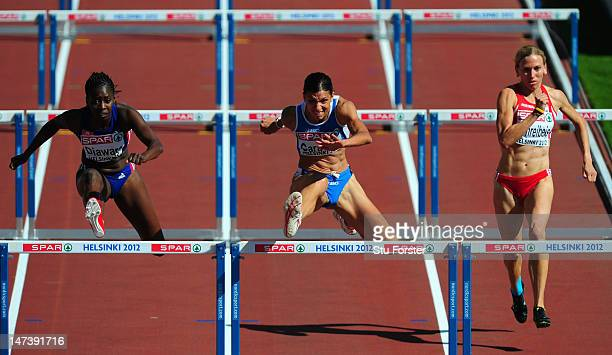 Marzia Caravelli of Italy Aisseta Diawara of France and Victoria Schreibeis of Austria compete in the Women's 100 Metres Hurdles Heats during day...