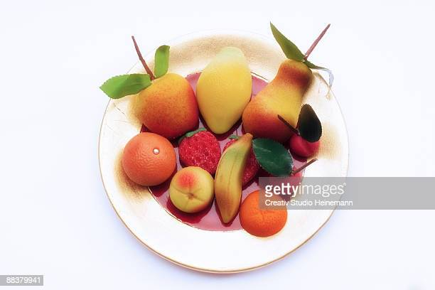 Marzipan fruits on plate, close-up