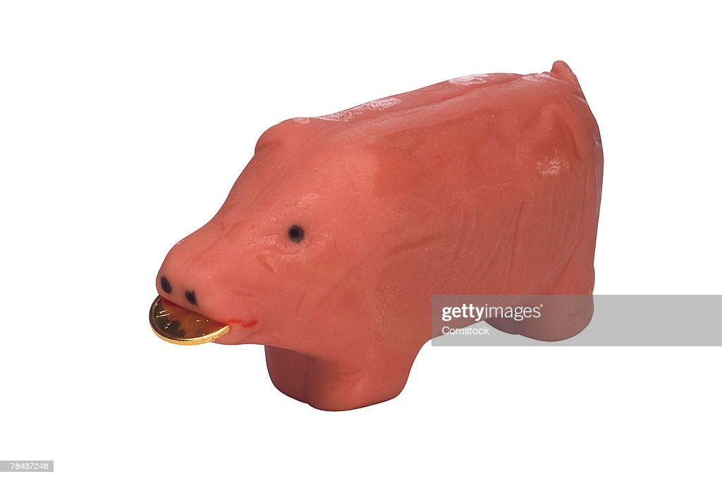 Marzipan pig with gold coin : Stockfoto