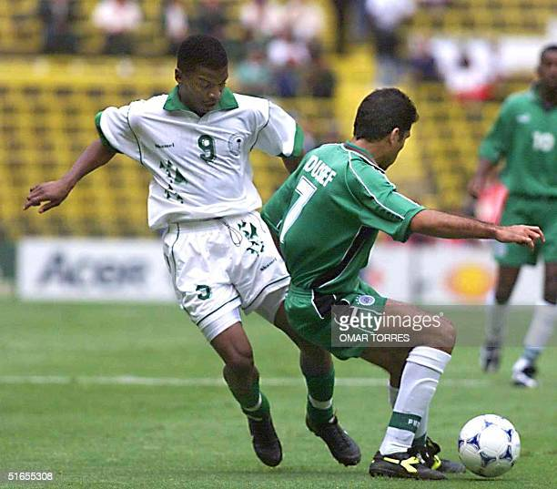 Marzouk alOtaibi of Saudi Arabia tries to steal the ball from Mohammed Youseff of Egypt 29 July 1999 during Confederation Cup soccer in Mexico City...