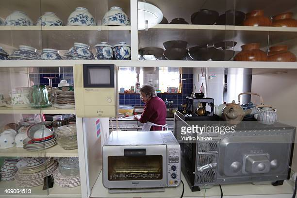 Masa Narita who just turned 100 years old on February 7 prepares a selfmade lunch inside her kitchen at her house on February 12 2014 in Osaka Japan...