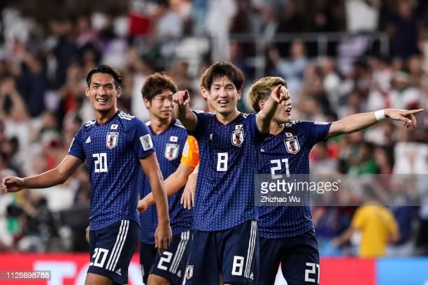 Masaaki and Makino Tomoaki and Haraguchi Genki and Doan Ritsu of Japan celebrate the victory after the AFC Asian Cup semi final match between Iran...