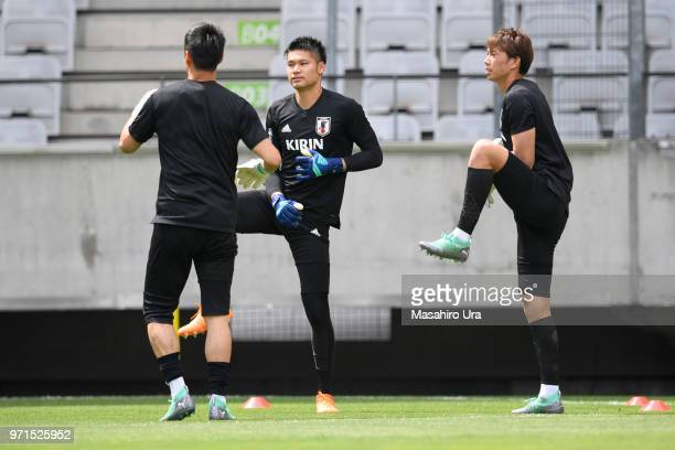 Masaaki Higashiguchi and Kosuke Nakamura of Japan in action during a training session ahead of the international friendly match between Japan and...