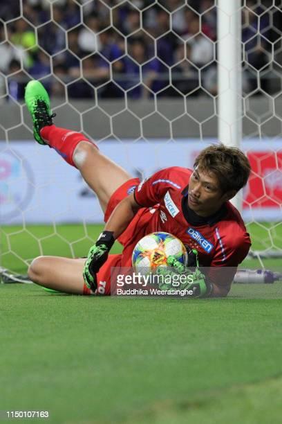 Masaaki Higashiguchi of Gamba Osaka goes down as catch the ball during the JLeague J1 match between Gamba Osaka and Cerezo Osaka at Panasonic Stadium...
