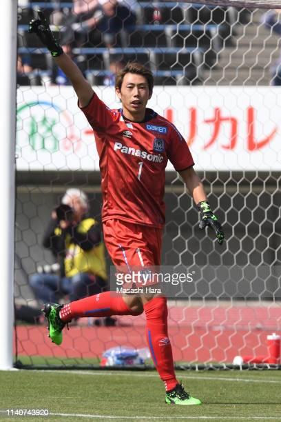 Masaaki Higashiguchi of Gamba Osaka looks on during the JLeague J1 match between Sanfrecce Hiroshima and Gamba Osaka at Edion Stadium Hiroshima on...