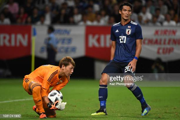 Masaaki Higashiguchi of Japan catches the ball while Tomoaki Makino of Japan covers during the international friendly match between Japan and Costa...