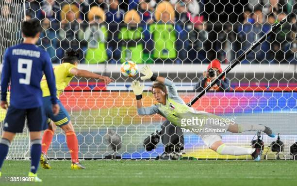 Masaaki Higashiguchi of Japan fails in vain as Radamel Falcao of Colombia scores the opening goal during the international friendly match between...