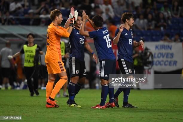 Masaaki Higashiguchi Tomoaki Makino and Hidemasa Morita of Japan celebrate their win after the international friendly match between Japan and Costa...
