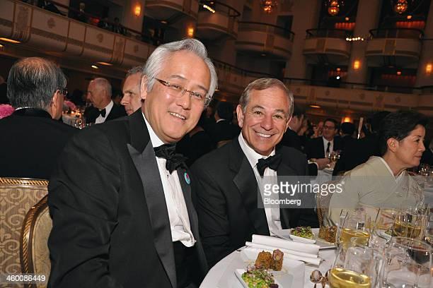 Masaaki Tanaka chief executive officer for the Americas of Bank of TokyoMitsubishi UFJ Ltd left and Robert Bobby Valentine former major league...