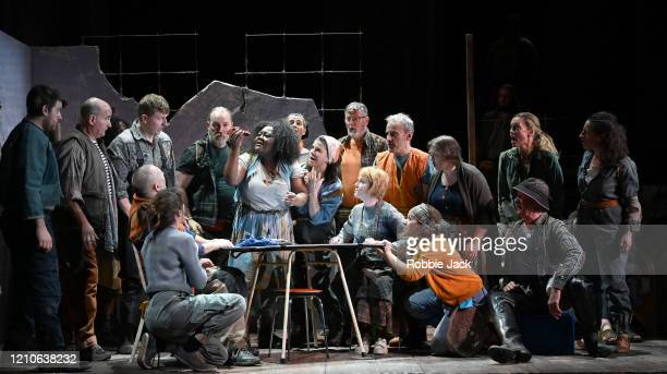 Masabane Cecilia Rangwanasha as Susanna with artists of the company in The Royal Opera's production of George Frideric Handel's Susanna directed by...