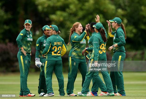 Masabata Klaas of South Africa celebrates a wicket with team mate Sune Luus during the ICC Women's World Cup warm up match between West Indies and...