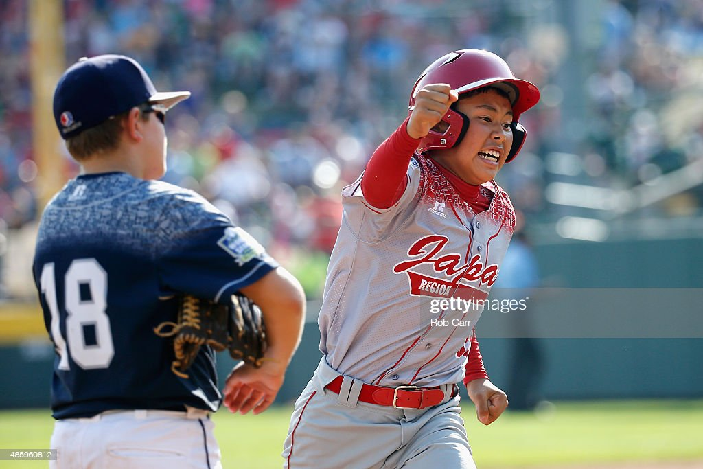 Masafuji Nishijima #16 of team Japan celebrates while rounding the bases in front of Dylan Rodenhaber #18 of the Mid-Atlantic team from Red Land Little League of Lewisberry, Pennsylvania after hitting a three RBI home run during the third inning of the Little League World Series Championship game at Lamade Stadium on August 30, 2015 in South Willamsport, Pennsylvania.