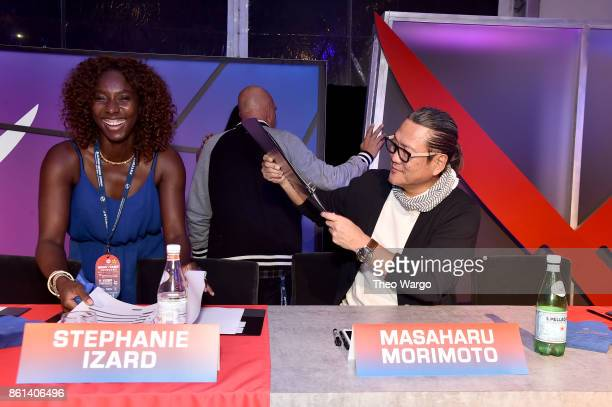 Masaharu Morimoto fans an assistant at the Food Network Cooking Channel New York City Wine Food Festival presented by CocaCola Rooftop Iron Chef...