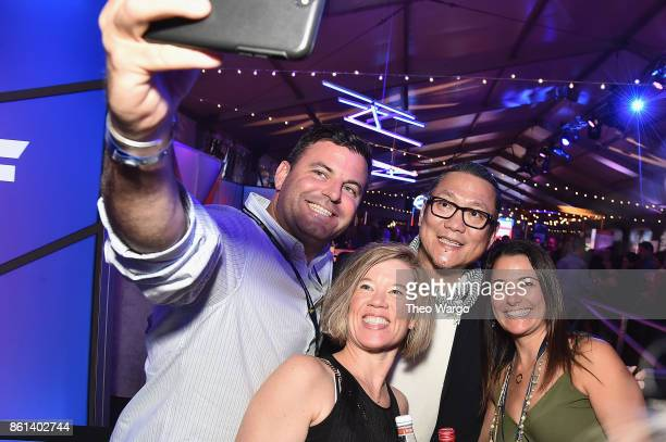 Masaharu Morimoto poses with fans at the Food Network Cooking Channel New York City Wine Food Festival presented by CocaCola Rooftop Iron Chef...