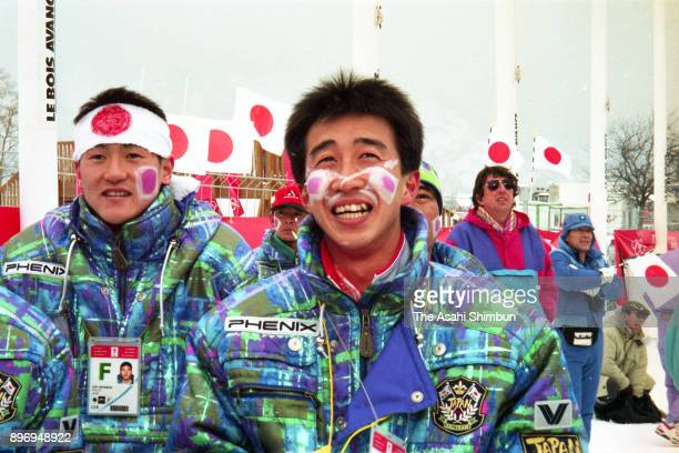 Masahiko Harada and Jiro Kamiharako cheer to Japan team during the Nordic Combined Team competition of the Albertville Winter Olympics at the...
