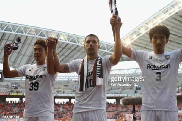 Masahiko Inoha Lukas Podolski and Hirofumi Watanabe of Vissel Kobe celebrate theirr 20 victory in the JLeague J1 match between Albirex Niigata and...