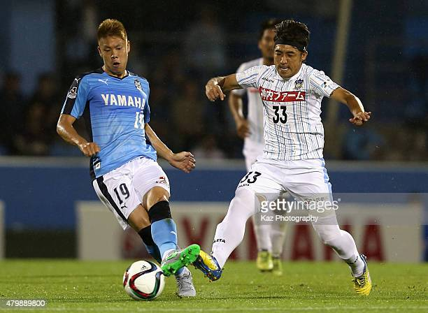 Masahiko Inoha of Iwata and Ryosuke Kijima of Sanuki compete for the ball during the JLeague second division match between Jubilo Iwata and...