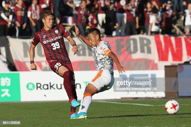 Masahiko Inoha of Vissel Kobe and Chong Tese of Shimizu SPulse compete for the ball during the JLeague J1 match between Vissel Kobe and Shimuzu...