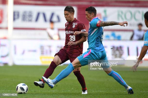 Masahiko Inoha of Vissel Kobe and Fernando Torres of Sagan Tosu compete for the ball during the JLeague J1 match between Vissel Kobe and Sagan Tosu...