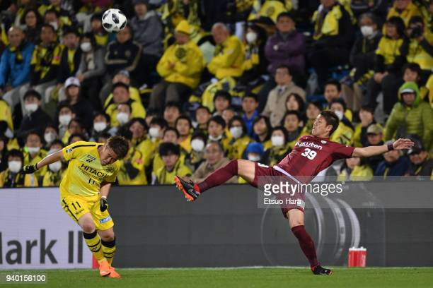 Masahiko Inoha of Vissel Kobe and Ryohei Yamazaki of Kashiwa Reysol compete for the ball during the JLeague J1 match between Kashiwa Reysol and...