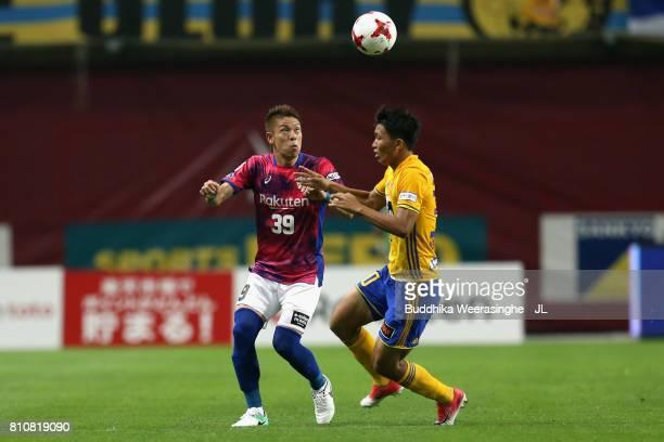 Masahiko Inoha of Vissel Kobe and Takuma Nishimura of Vegalta Sendai compete for the ball during the JLeague J1 match between Vissel Kobe and Vegalta...