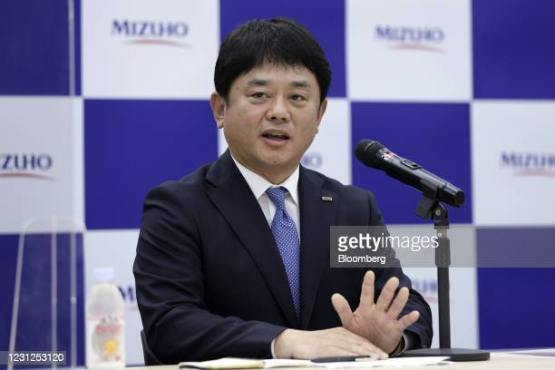 Masahiko Kato, incoming president and chief executive officer of Mizuho Bank Ltd., gestures while speaking during a news conference in Tokyo, Japan,...