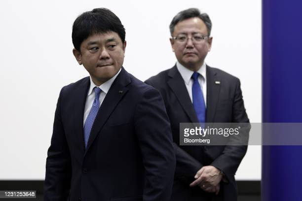 Masahiko Kato, incoming president and chief executive officer of Mizuho Bank Ltd., left, and Yoshiro Hamamoto, incoming president and chief executive...