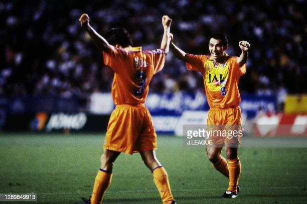 Masahiro Ando of Shimizu S-Pulse celebrates scoring his side's second goal with his team mate Kenta Hasegawa during the J.League first stage match...