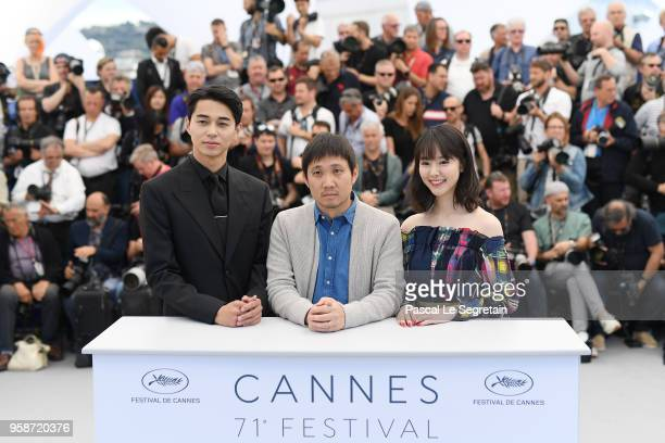 Masahiro Higashide director Ryusuke Hamaguchi and Erika Karata attend the photocall for Asako I II during the 71st annual Cannes Film Festival at...