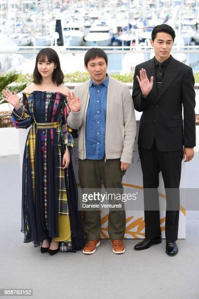 Masahiro Higashide director Ryusuke Hamaguchi and Erika Karata attends the photocall for the Asako I II during the 71st annual Cannes Film Festival...