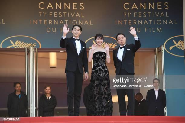 Masahiro Higashide Erika Karata and director Ryusuke Hamaguchi attends the screening of Asako I II during the 71st annual Cannes Film Festival at...