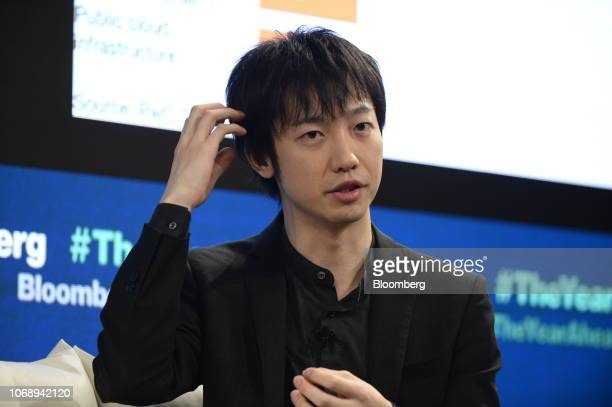 Masahiro Kasuya chief executive officer of Meltin MMI gestures as he speaks during the Bloomberg Year Ahead summit in Tokyo Japan on Thursday Dec 6...