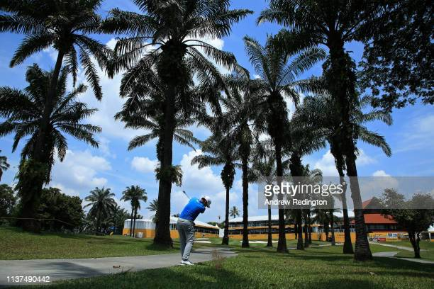 Masahiro Kawamura of Japan plays his third shot on the 18th hole on Day Two of the Maybank Championship at at Saujana Golf Country Club Palm Course...