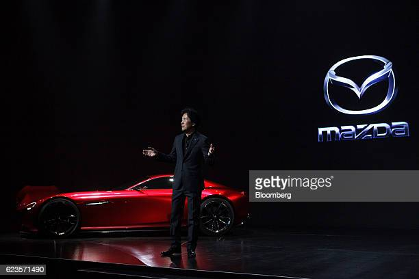 Masahiro Moro president and chief executive officer of North American operations at Mazda Motor Corp speaks as a Mazda RXVision concept vehicle is...