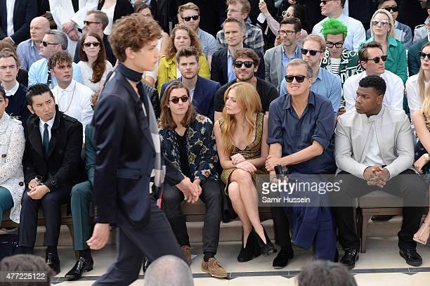 Masahiro Motoki Oscar Tuttiett Clara Paget Mario Testino and John Boyega sit in the front row at Burberry Menswear Spring/Summer 2016 show at...
