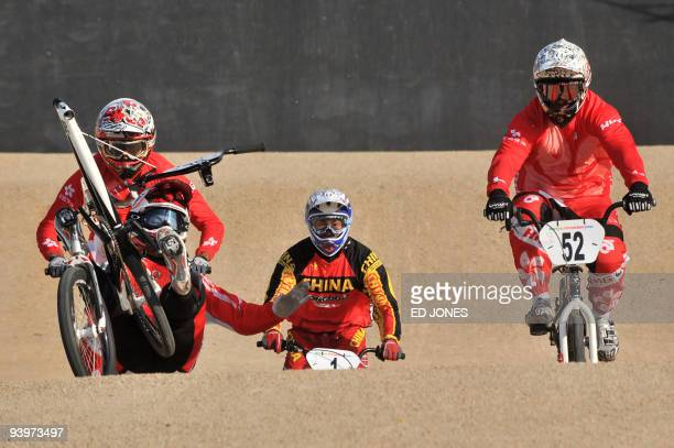 Masahiro Sampei of Japan succumbs to a fall as the handlebars and front wheel of his BMX bike detach as he competes during the first round of the...