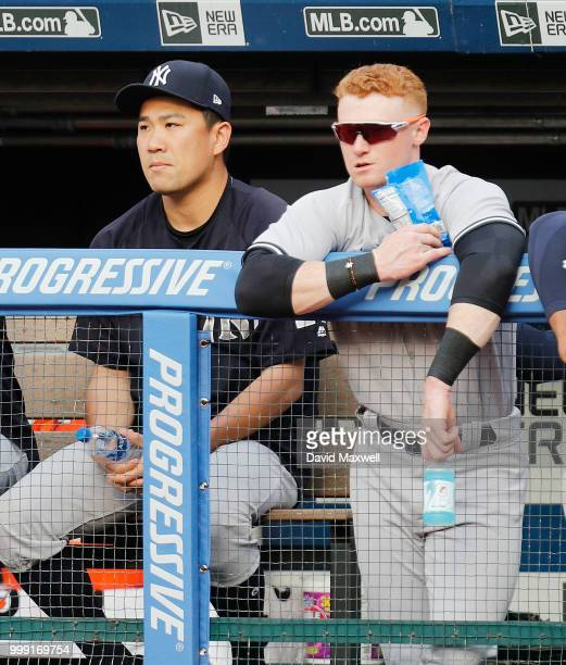 Masahiro Tanaka and Clint Frazier of the New York Yankees watch from the dugout in the first inning against the Cleveland Indians at Progressive...