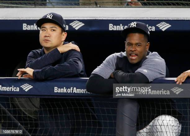 Masahiro Tanaka and Luis Severino of the New York Yankees look on from the dugout during the first inning against the Boston Red Sox at Yankee...
