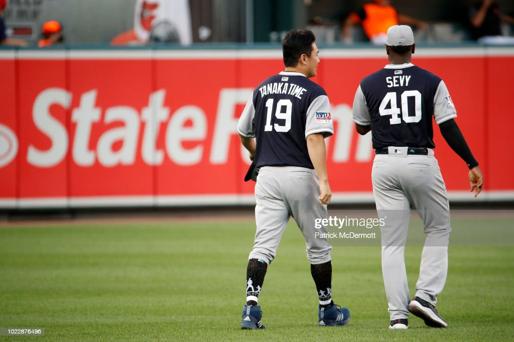 Masahiro Tanaka #19 and Luis Severino #40 of the New York Yankees talk before a game against the Baltimore Orioles at Oriole Park at Camden Yards on August 24, 2018 in Baltimore, Maryland.
