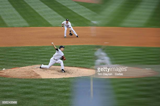 Masahiro Tanaka New York Yankees reflected while pitching during the New York Yankees V Tampa Bay Rays Major League Baseball game at Yankee Stadium...