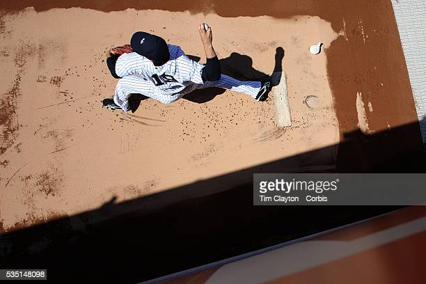 Masahiro Tanaka New York Yankees warming up in the bull pen before the New York Yankees V Chicago Cubs double header game one at Yankee Stadium The...